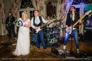 Bride-Groom-On-Stage-With-Live-Wedding-Band